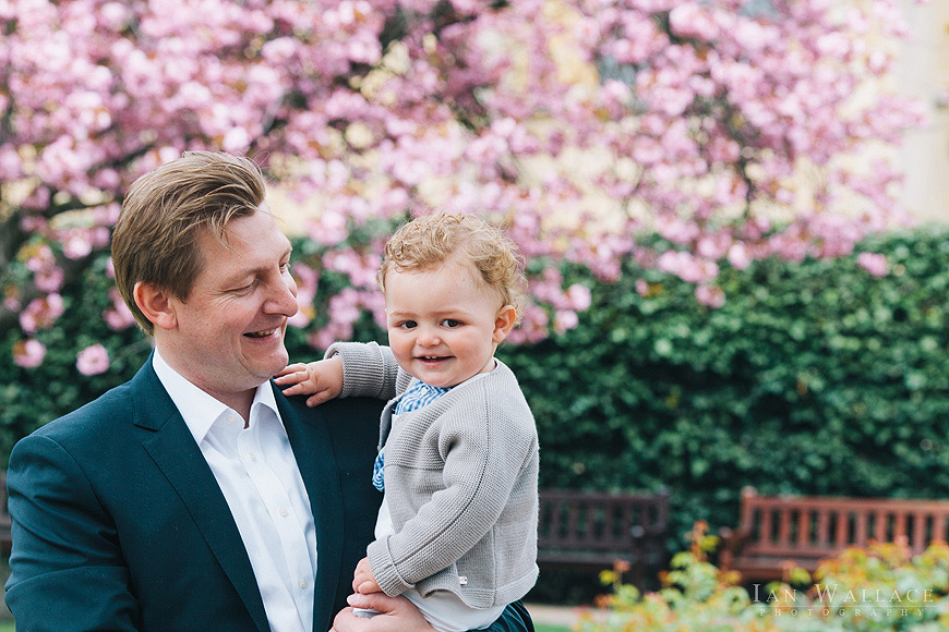 Father and son portrait with tree blossom outside St. Luke's church