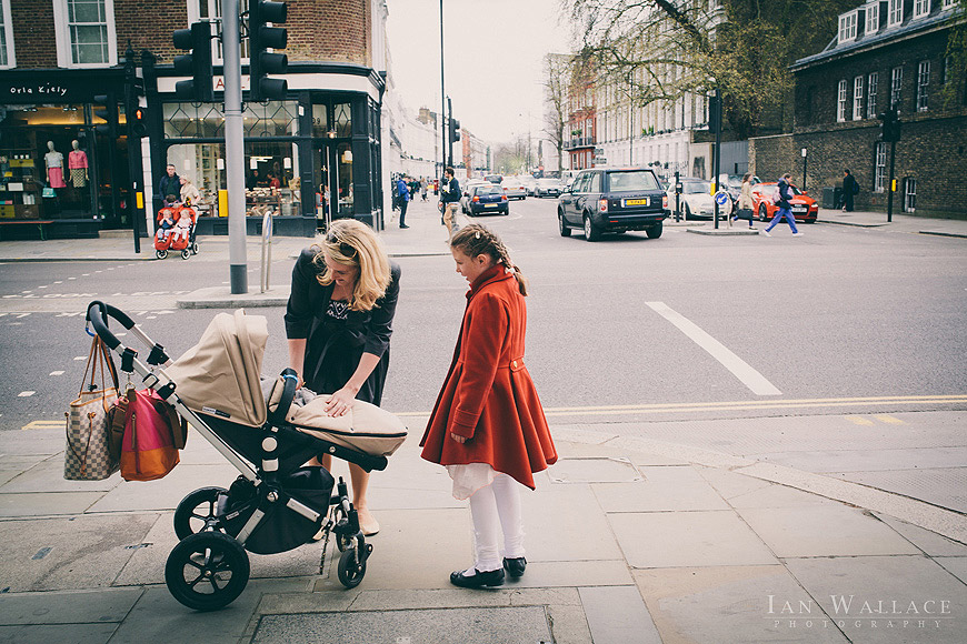 Checking the push chair occupant on Kings Road, London