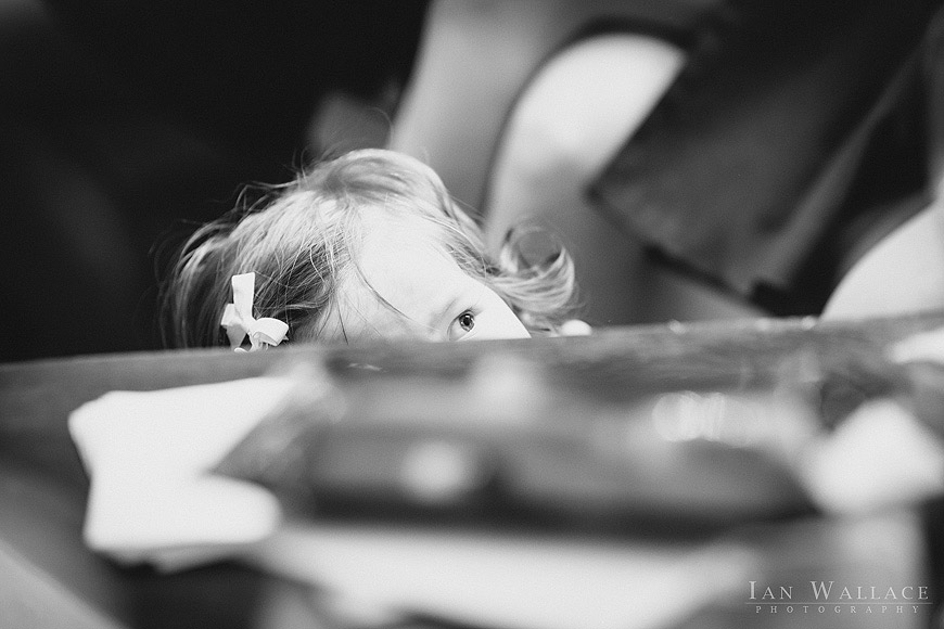 A child peaking over the top of a table