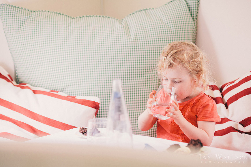 A child enjoying a drink in a restaurant in London