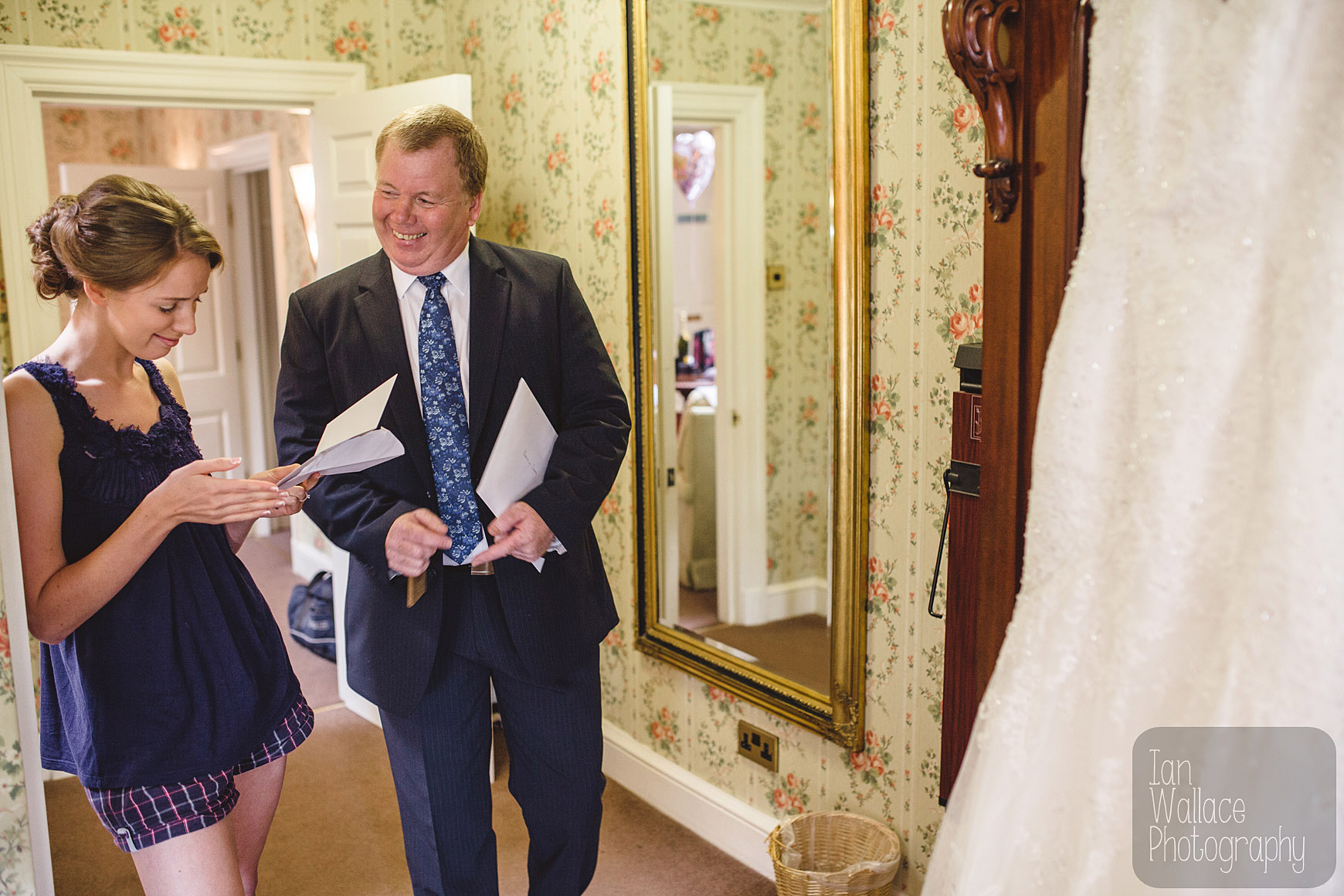 Father of the Bride giving her a card on her wedding day. Tears ensue.