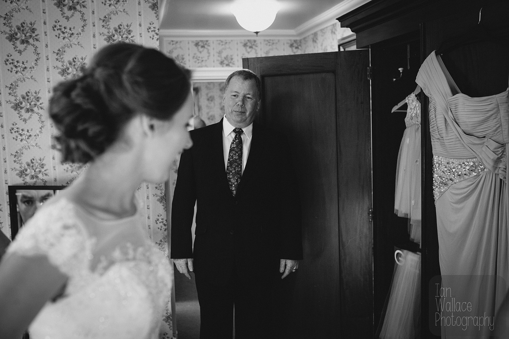 Father of the Bride arrives and sees his daughter in her dress for the first time.