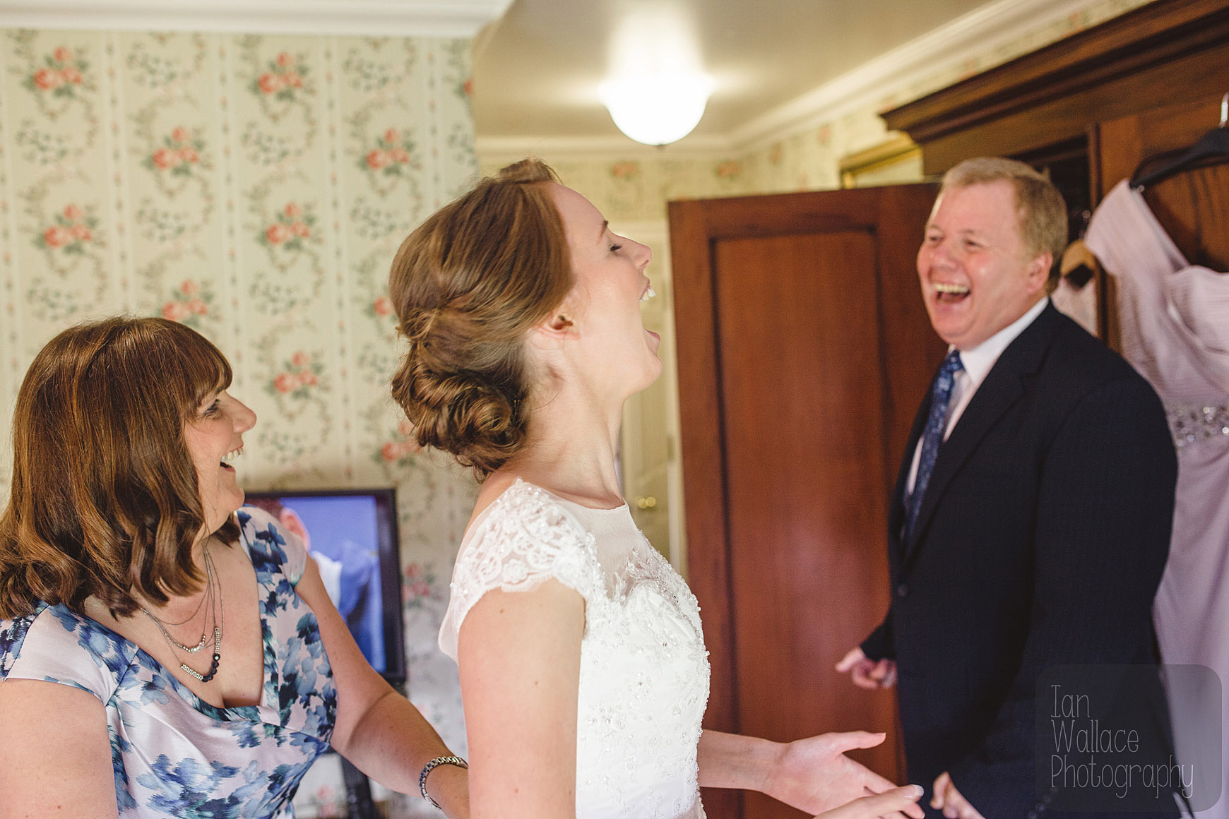 Father, mother and daughter laughing breaking the nerves.