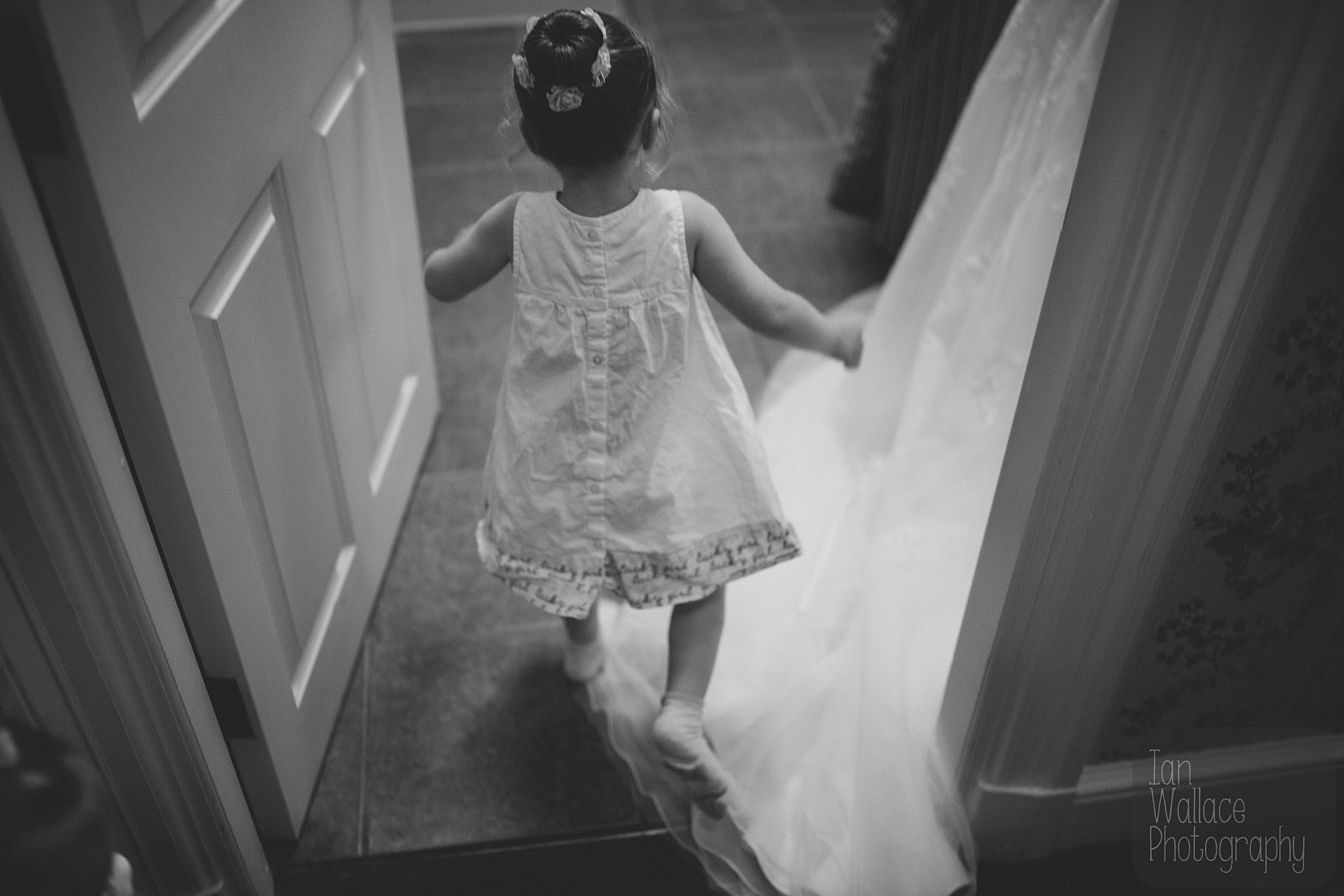 Abstract shot of girl running around during bridal preparations