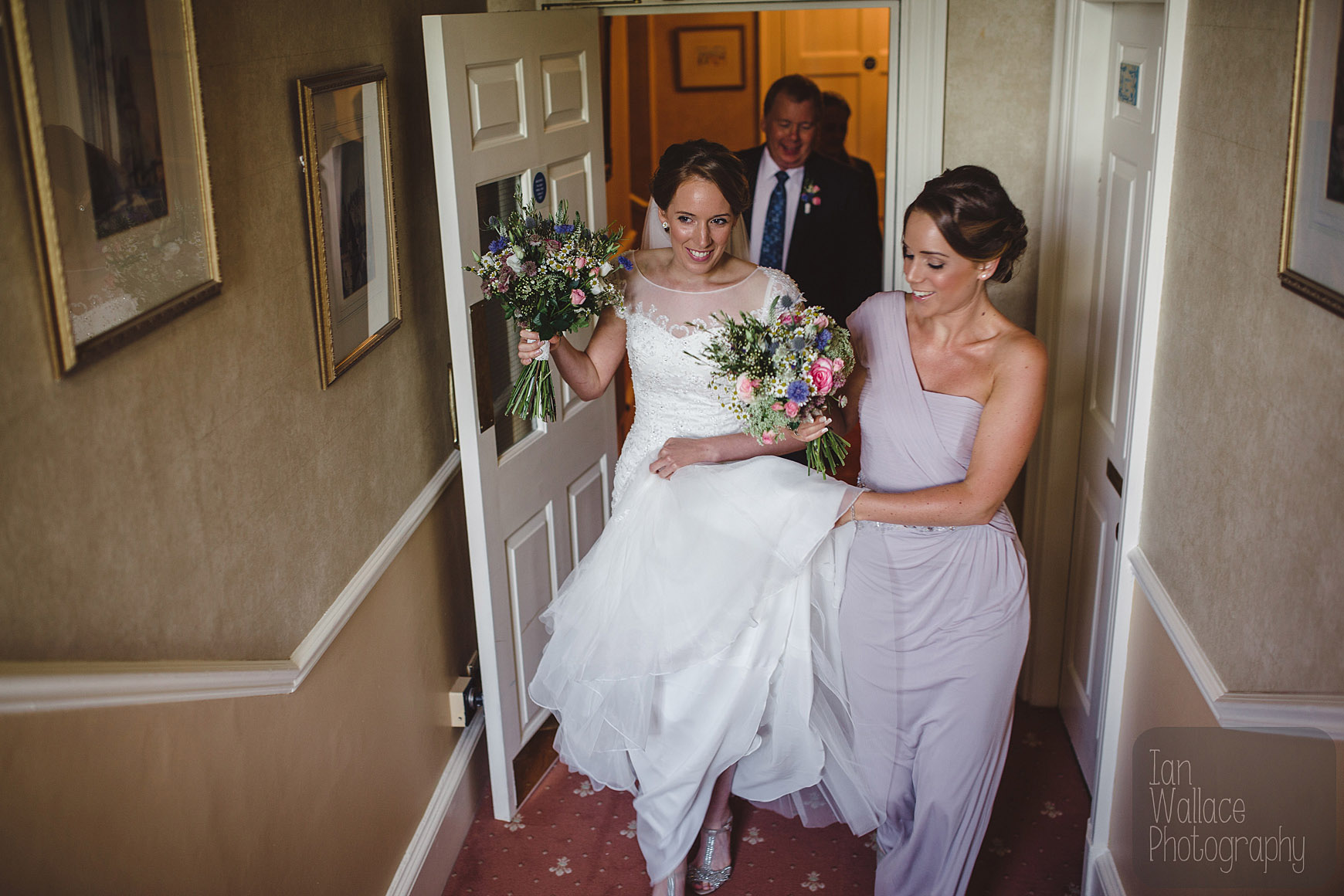Bride, sister and father walking through the corridors on the way to the ceremony
