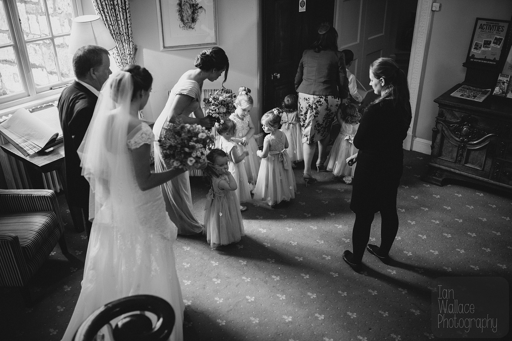 Moments before the ceremony. Bride and flower-girls gather and get organised.