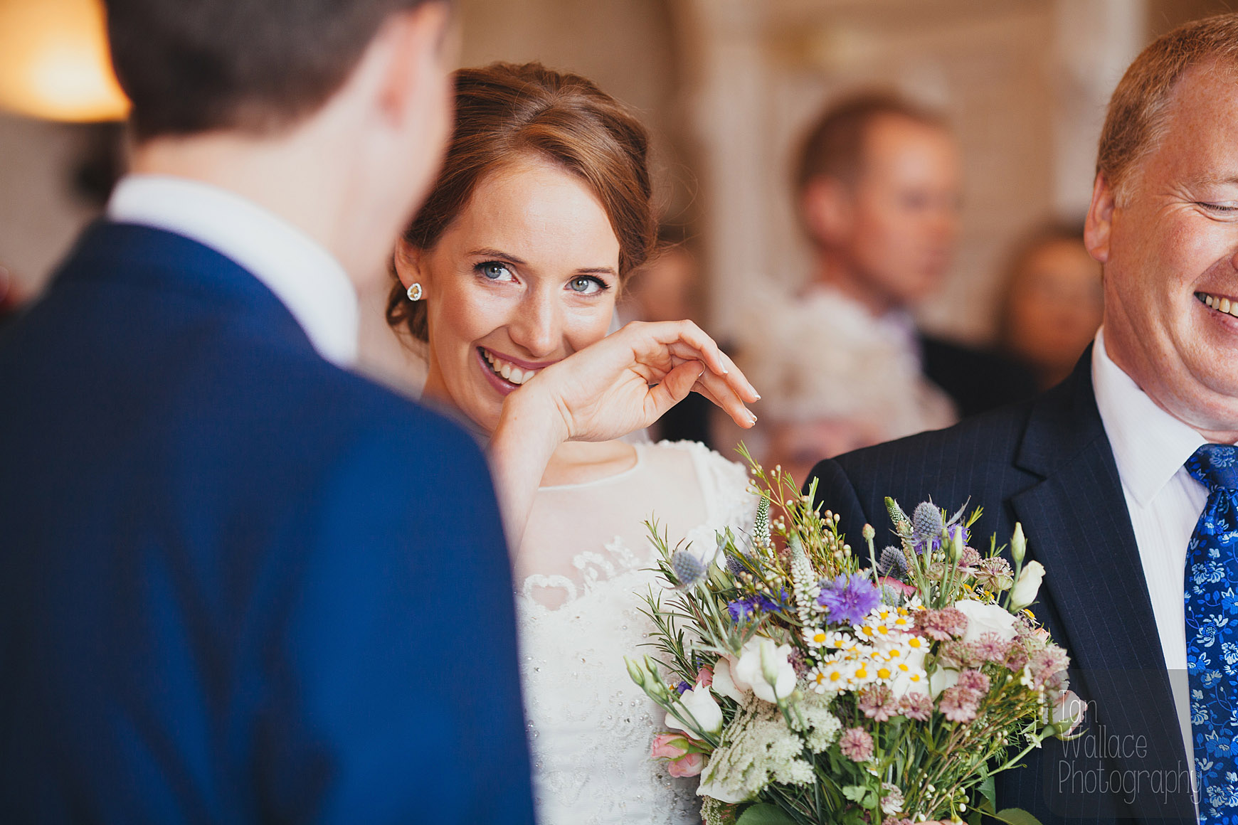 Tender moment as bride and groom see each other for the first time.
