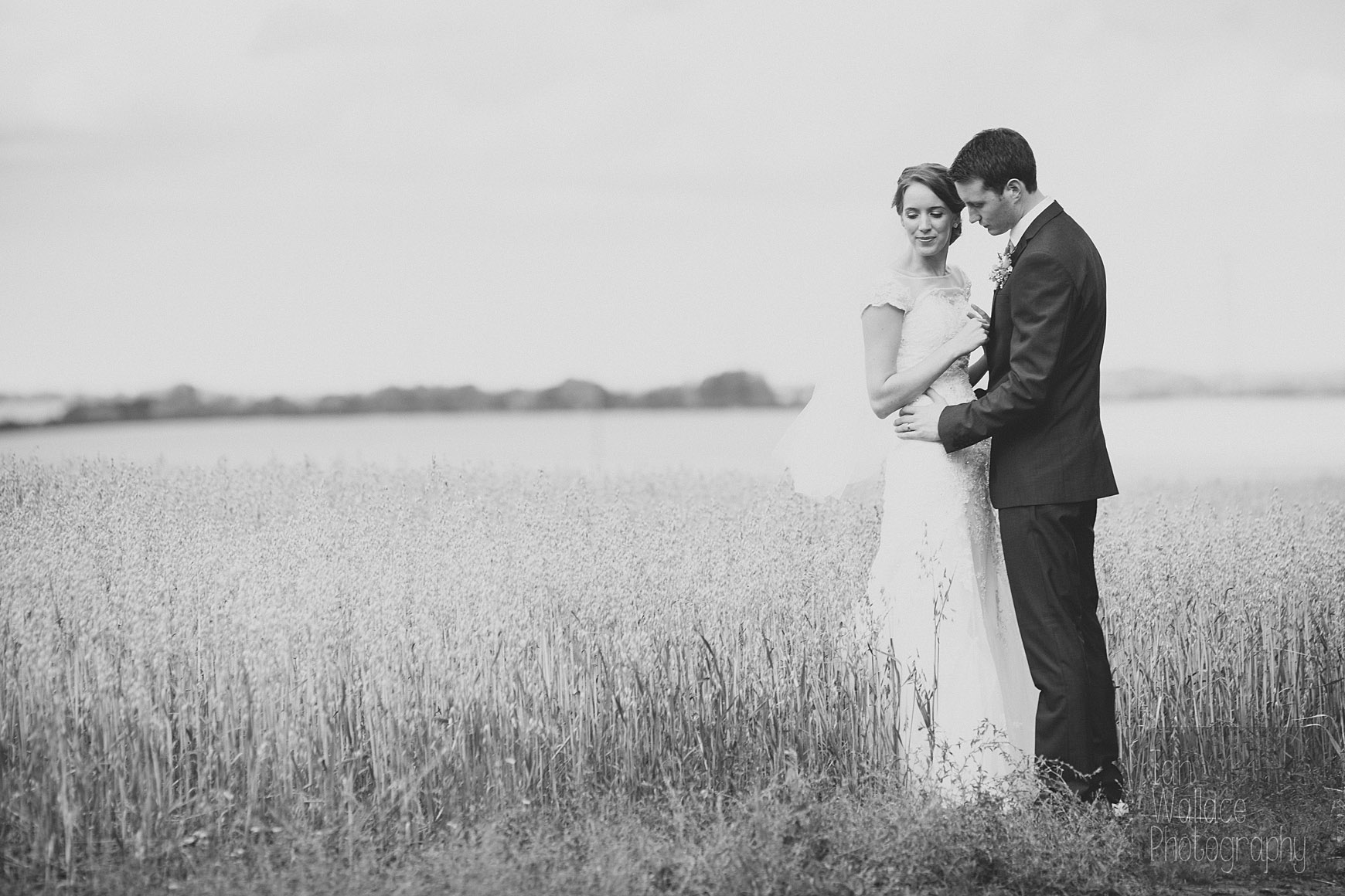 Fine art wedding photography - bride and groom in a corn field