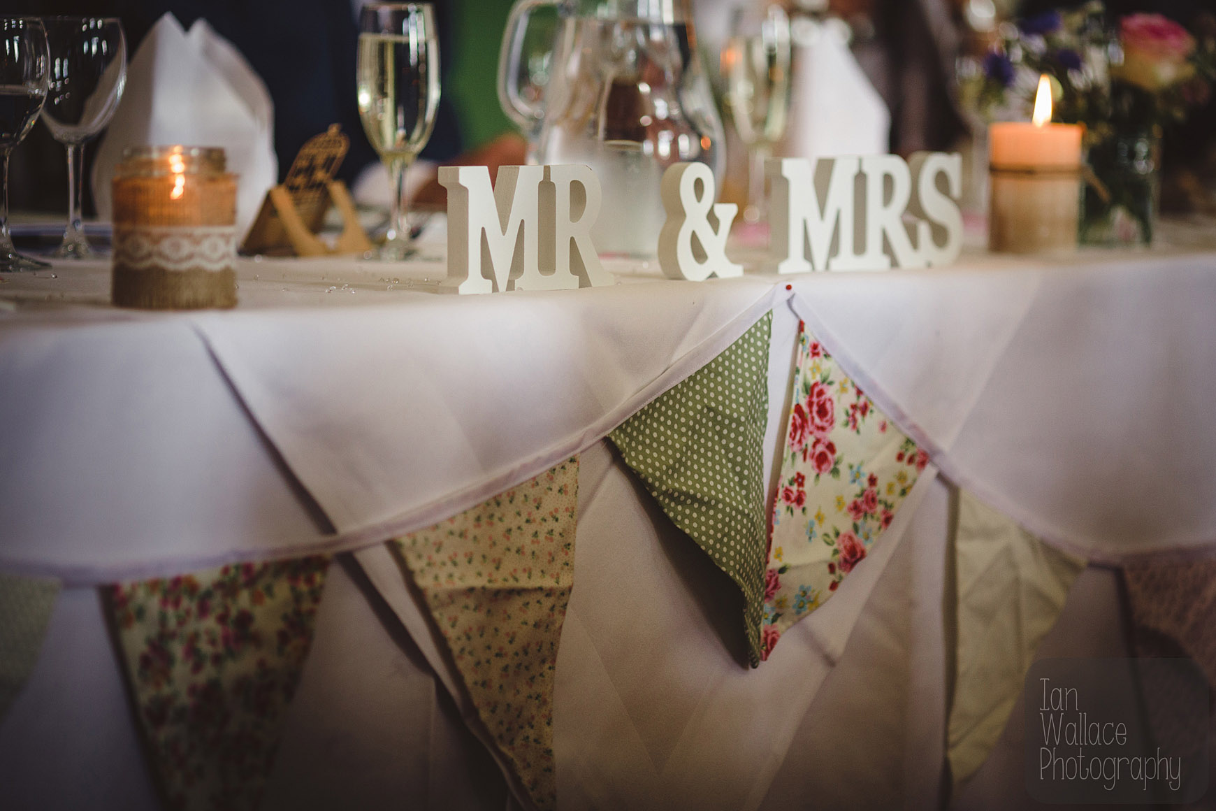 Mr and Mrs sign and bunting during wedding breakfast.