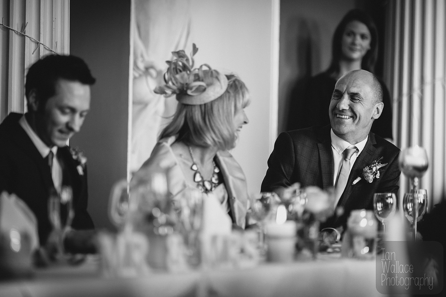 Groom's parents laughing between themselves during speeches