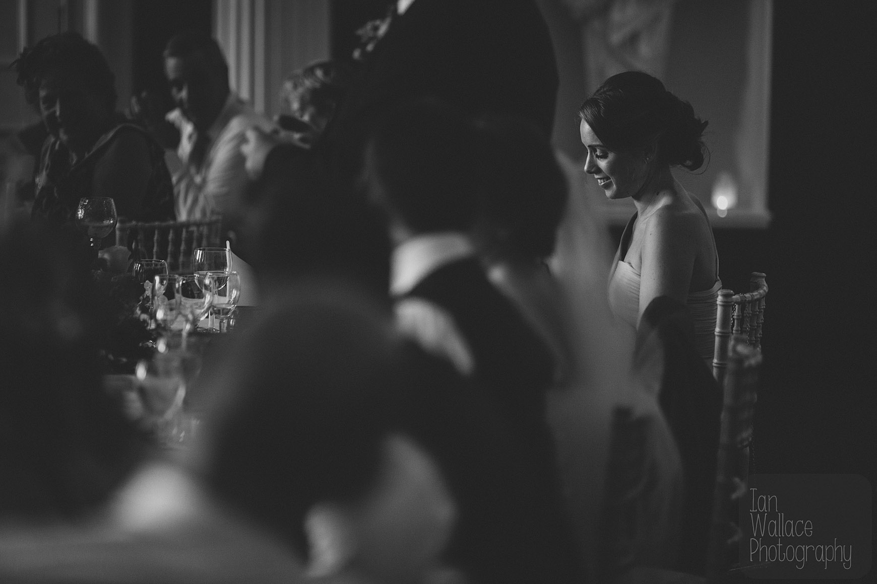 Beautiful light in a moody shot of the bride during speeches.