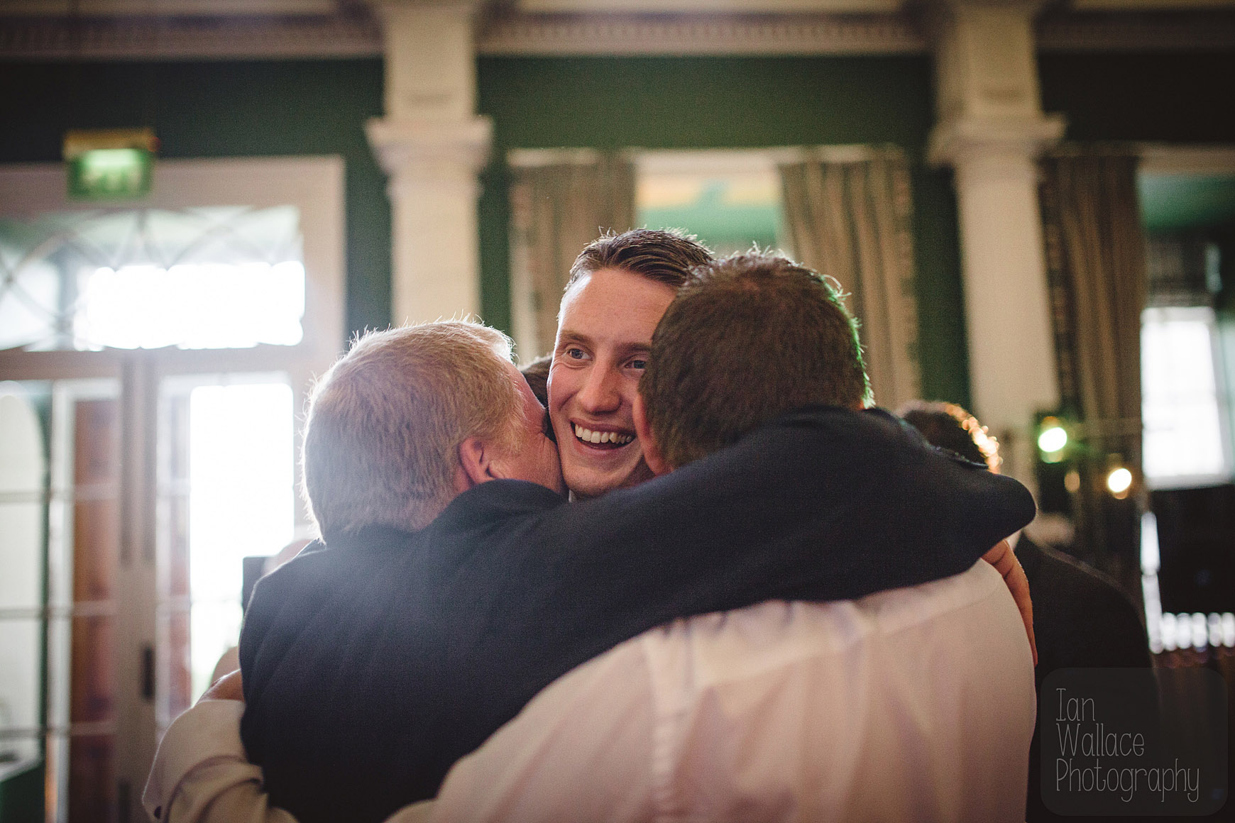 The groom getting mobbed by his friends after the first dance.