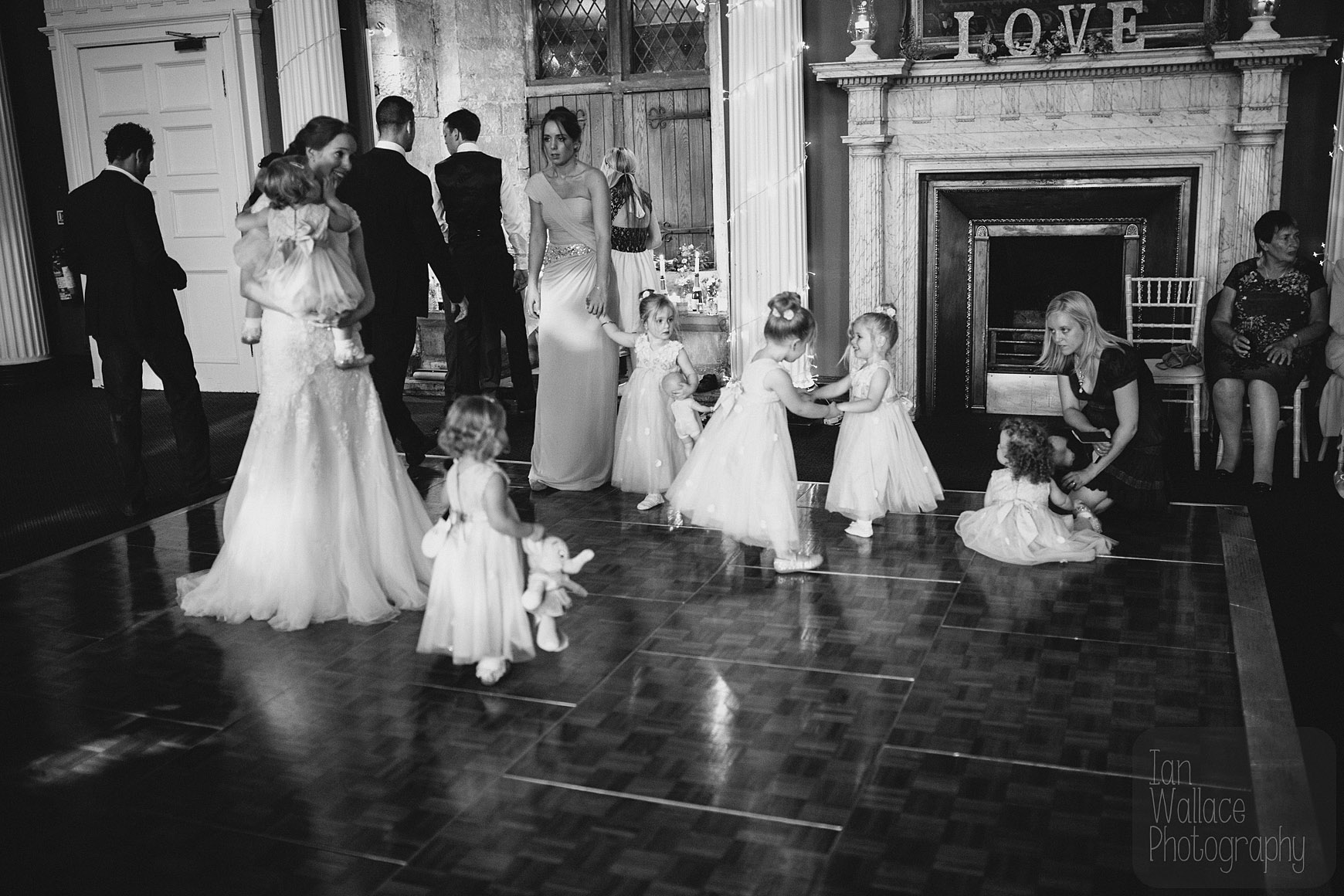 Bride, bridesmaid and all the children owning the dance floor