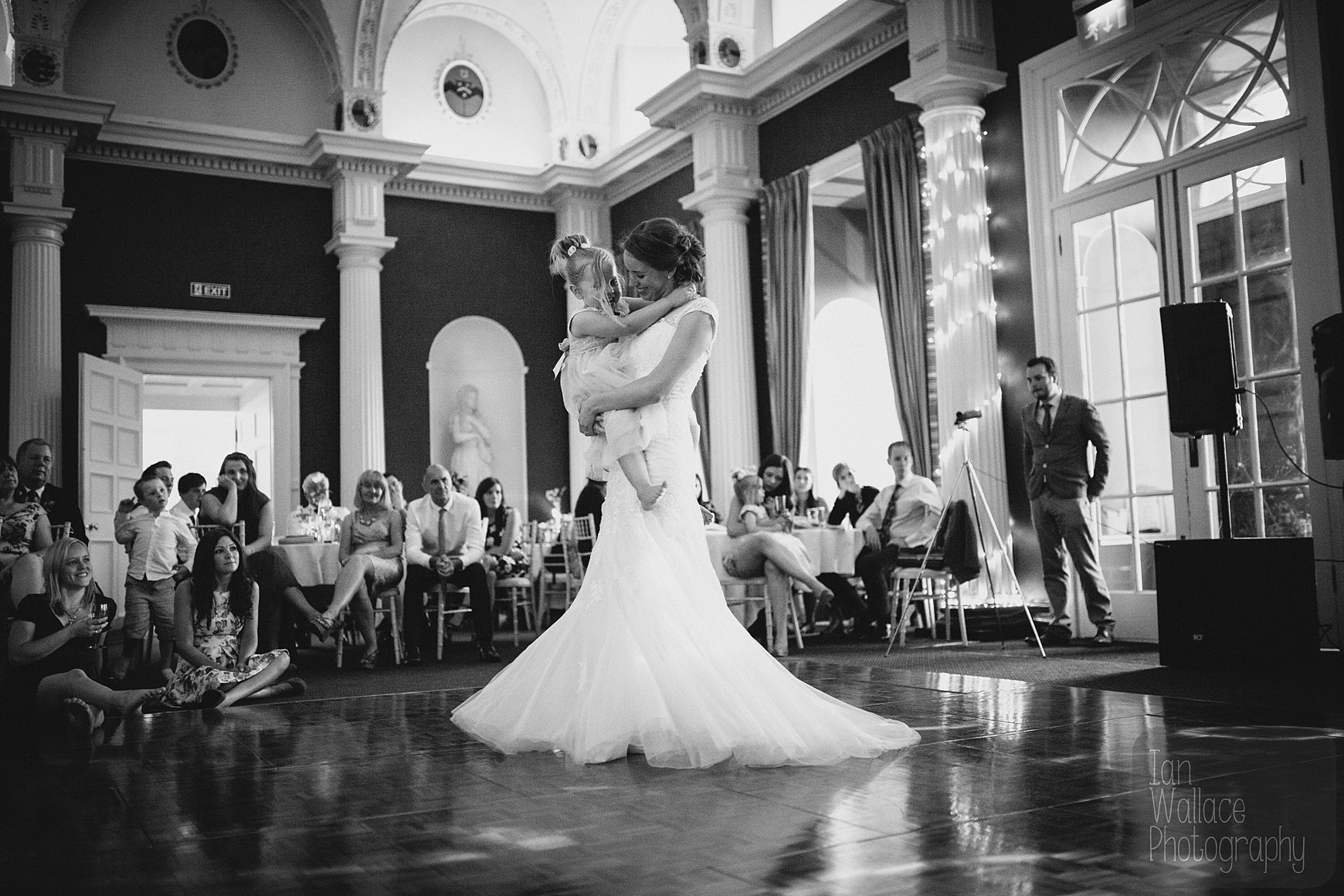 The bride spinning like a princess with a flower-girl on the dance floor