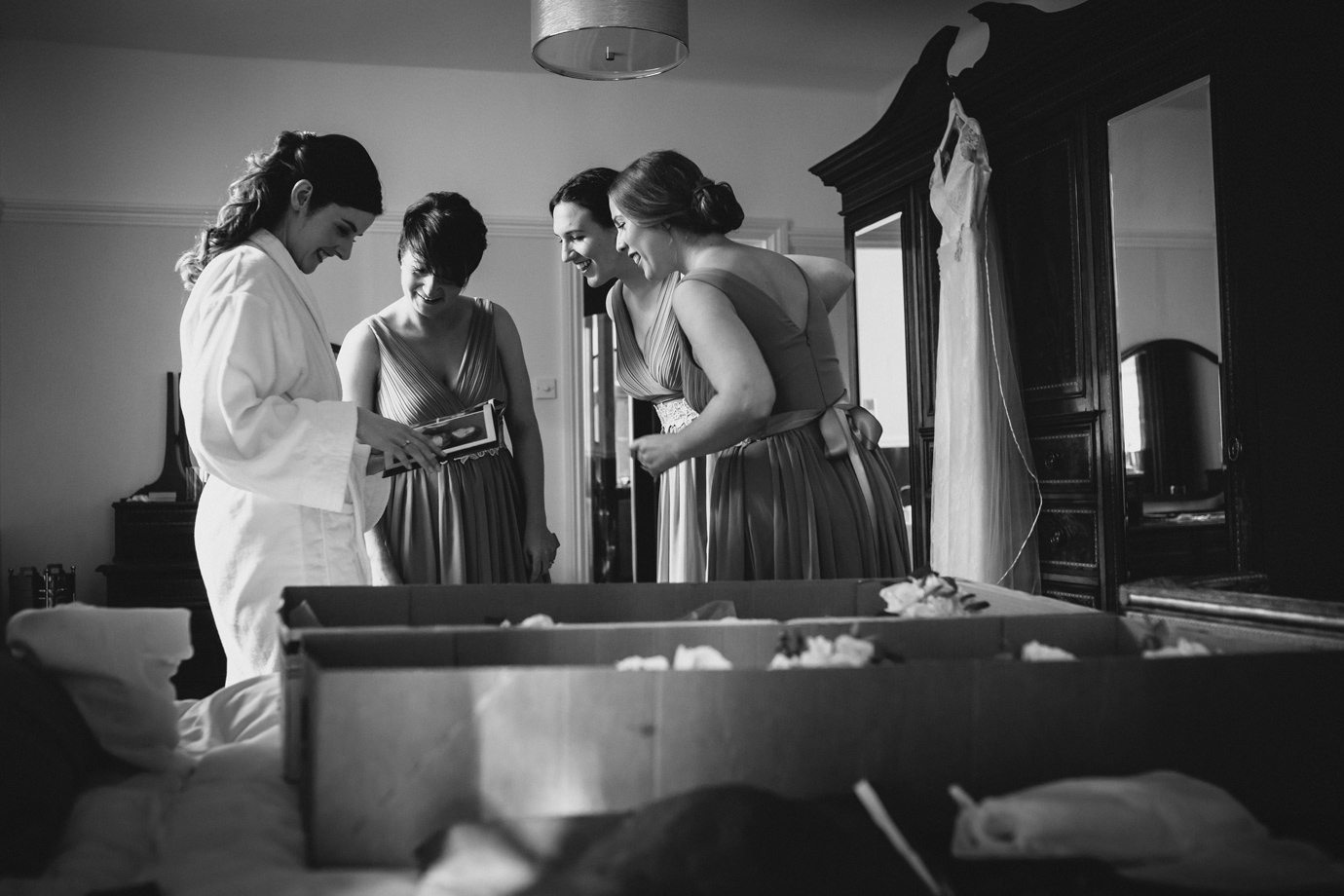 Reportage photograph of bride and bridesmaids during preparations