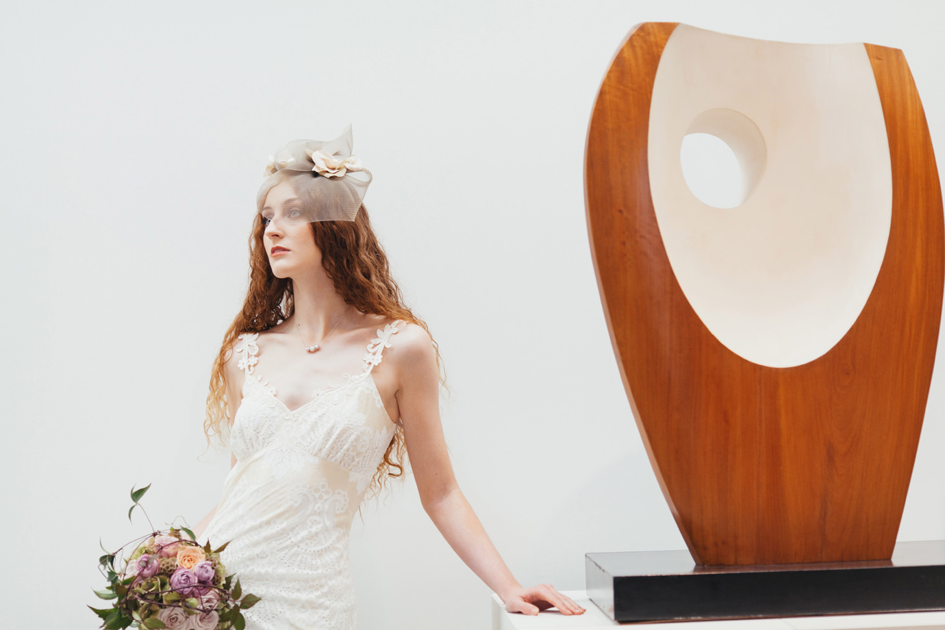 Model against Hepworth artwork, autumnal bridal flowers