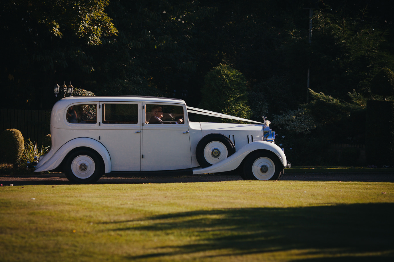 Arriving at the wedding reception venue vintage car Hemswell Court