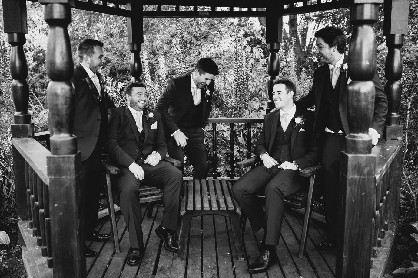 Belly laughs during groom party portraits Hemswell Court wedding photography