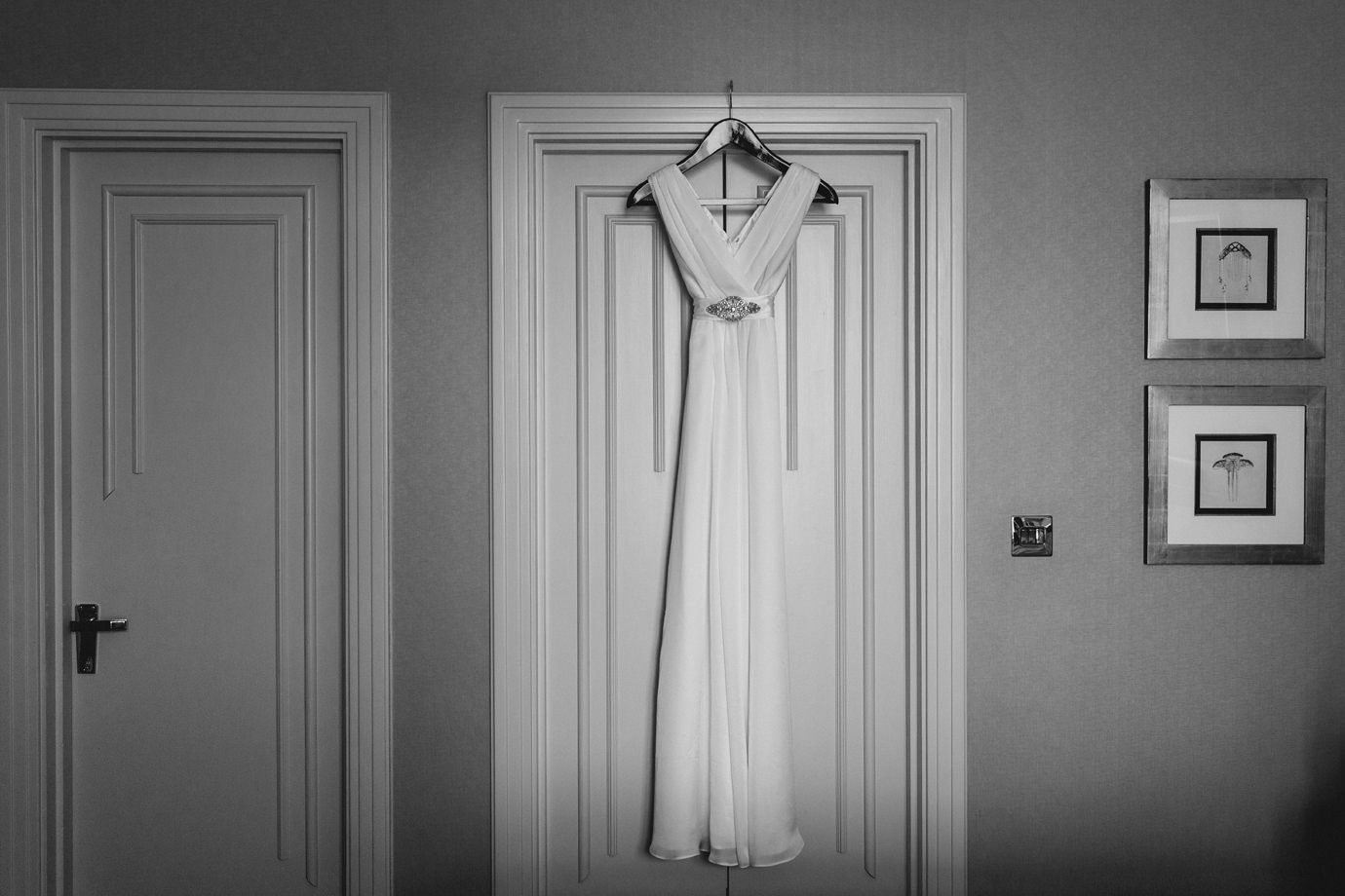 Beautiful Tiffany Rose maternity wedding dress against an art deco Savoy hotel room