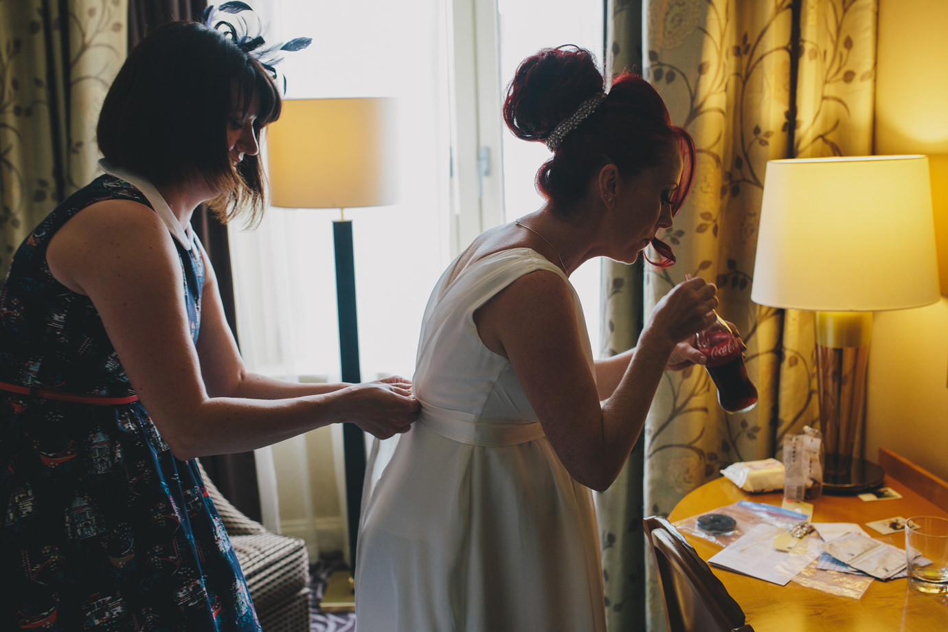 Finishing touches during bridal prep, London documentary wedding photography