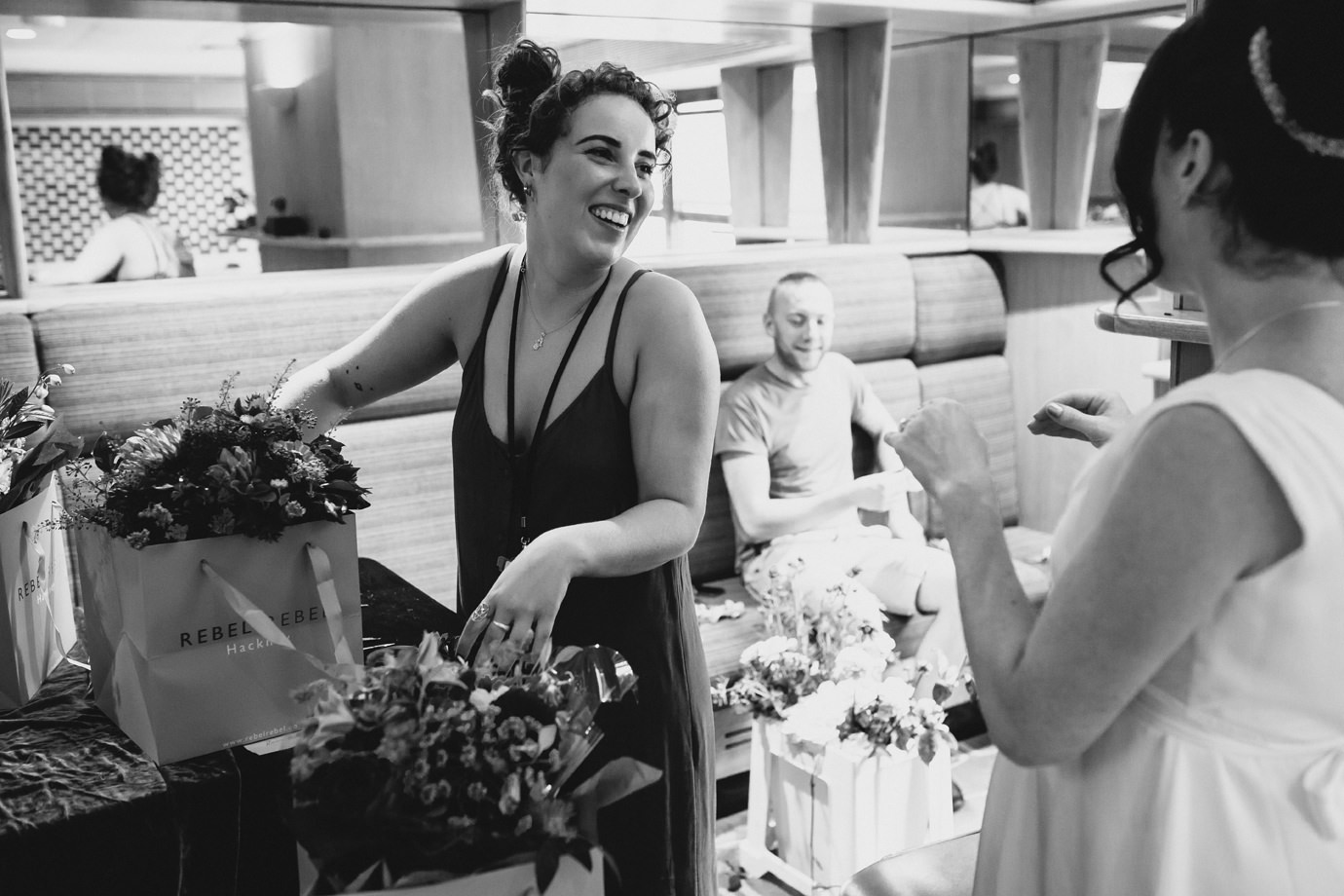 Picking up the flowers, Southbank documentary wedding photography