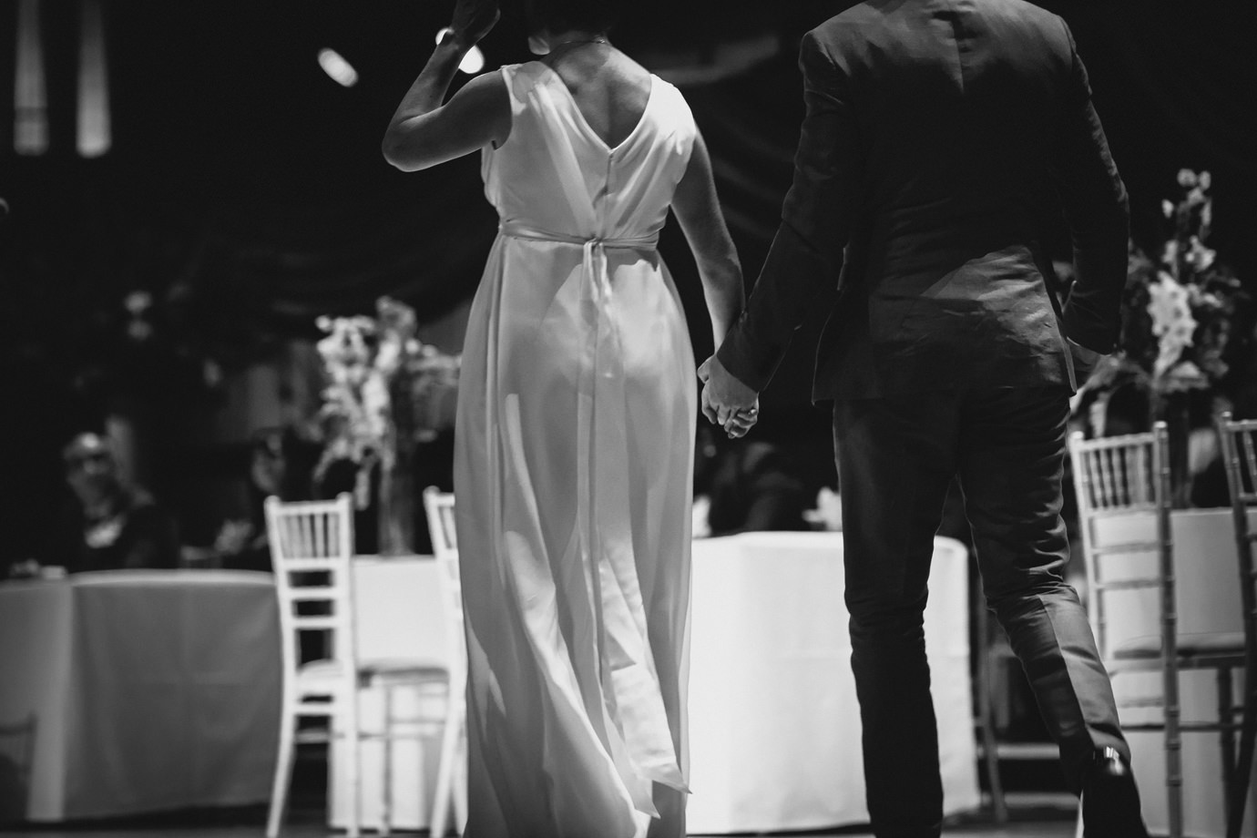 Couple holding hands on stage, Royal Festival Hall, documentary wedding photography