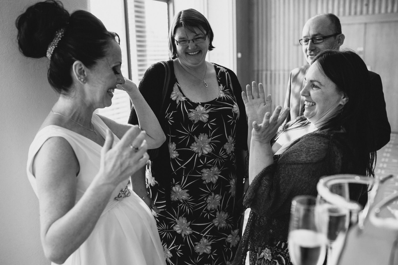 Bride meeting family and friends, candid wedding photography, London