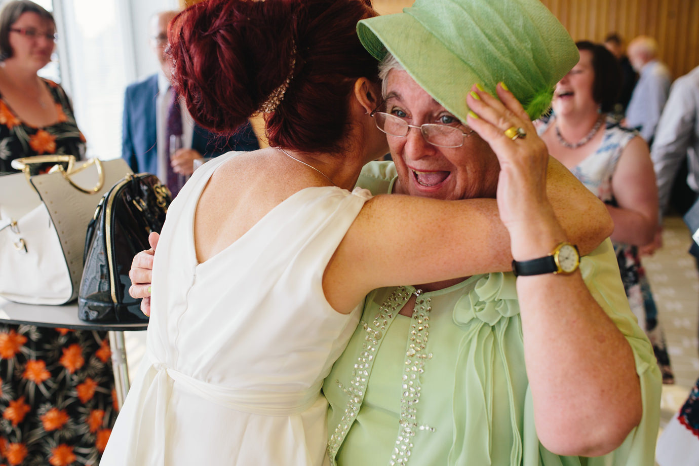 Bride hugging Mum, natural wedding photography, Royal Festival Hall, London