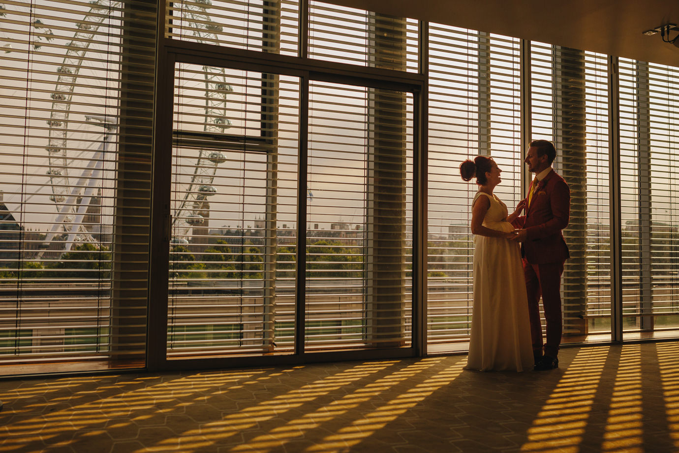 Bride and Groom, in the Royal Festival Hall, against the London Eye and Southbank backdrop
