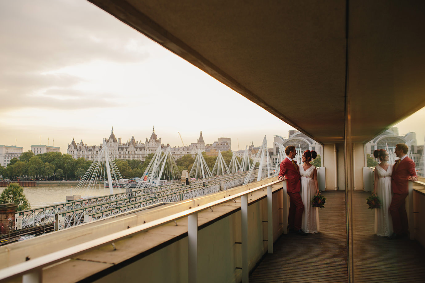 Bride and Groom, with view of Southbank, Thames, Charring Cross station, London wedding photography