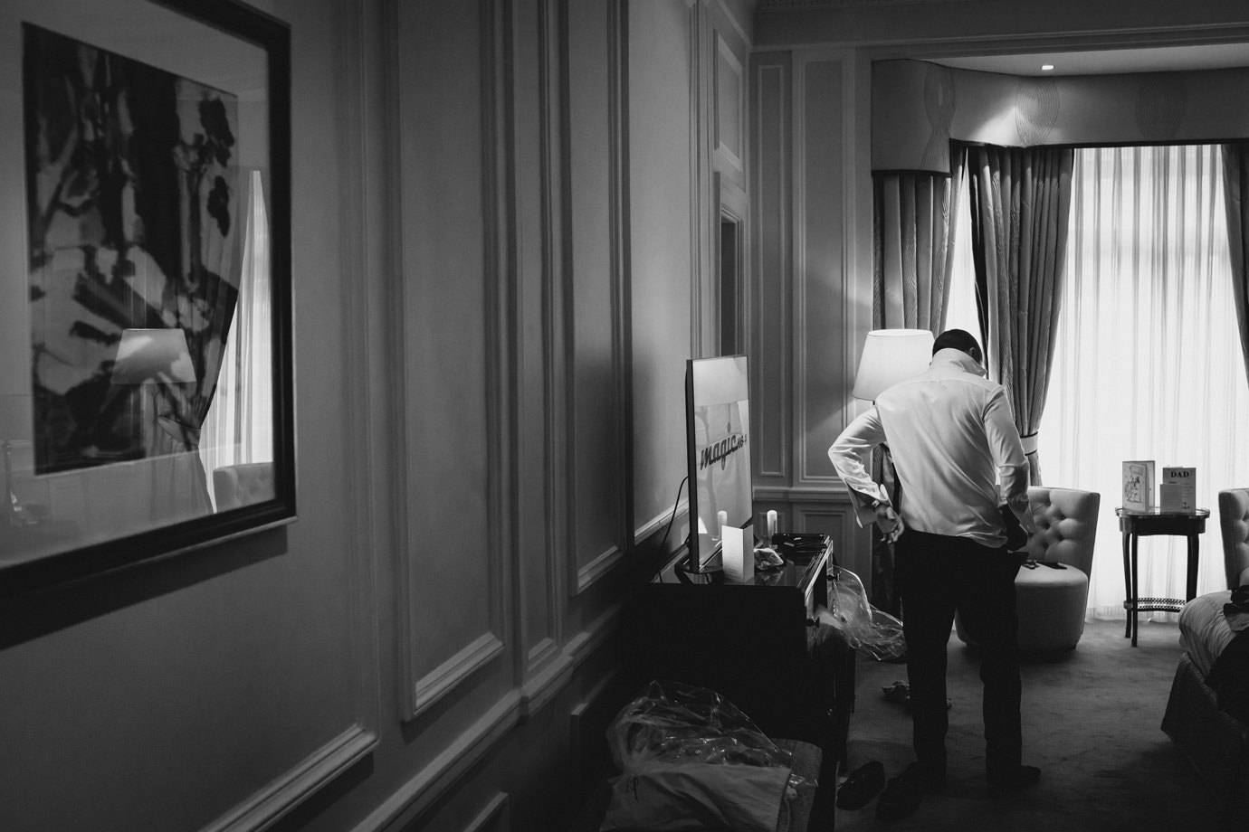 Dressing groom claridges hotel documentary wedding photography