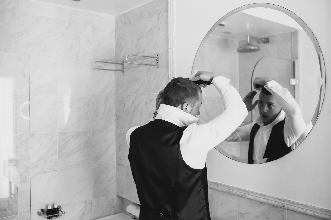 Hair prep in claridges hotel mirror in the bathroom