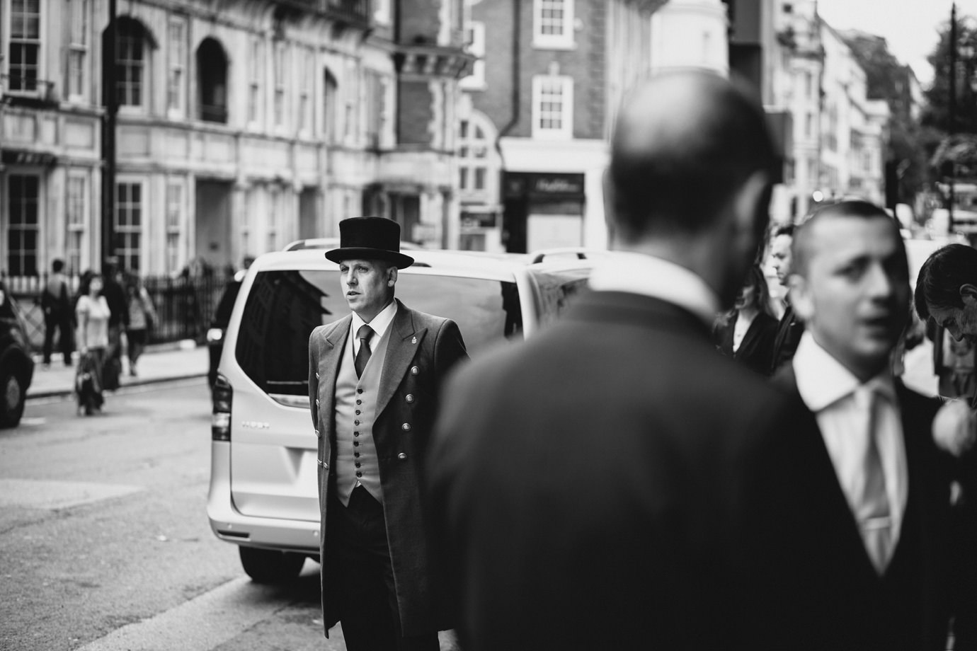 Waiting outside Claridges London, documentary wedding photography