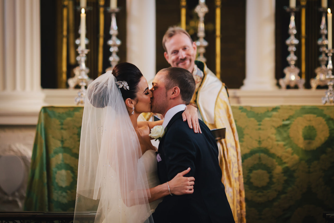 The first kiss, London wedding photography, Grosvenor Chapel, Mayfair