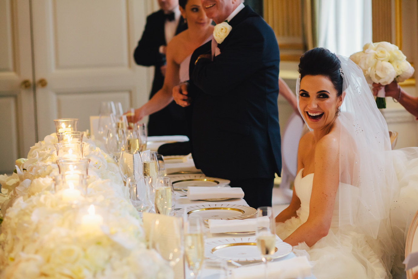 Bride laughing during the speeches, Claridges