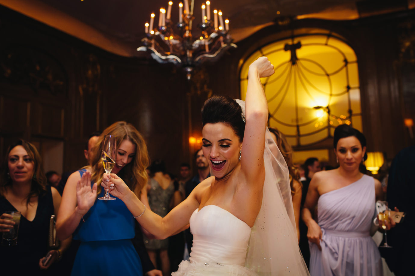 Bride partying on wedding day. Claridges, London
