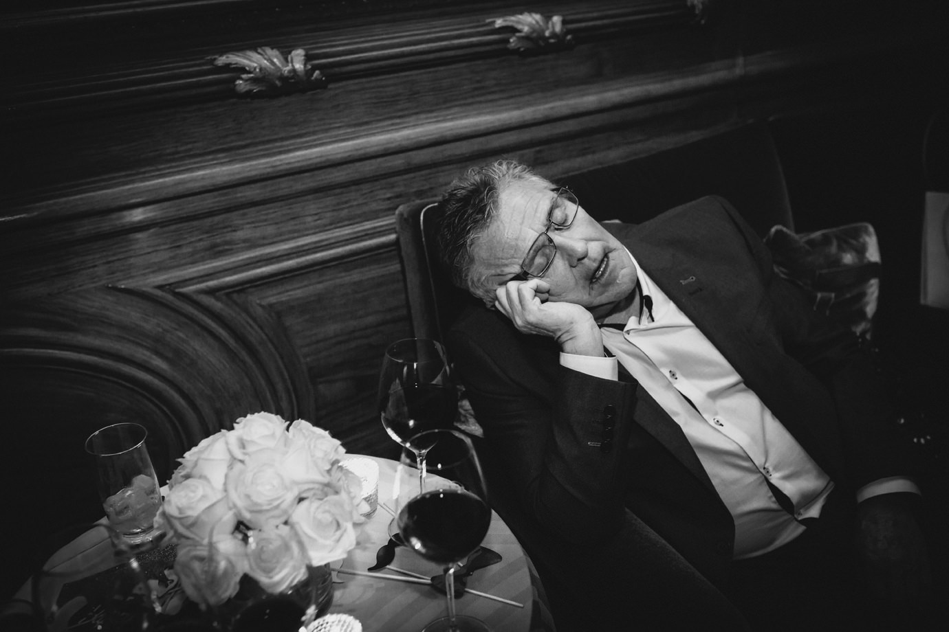 Partied out. Having a snooze during the party. Documentary wedding photography
