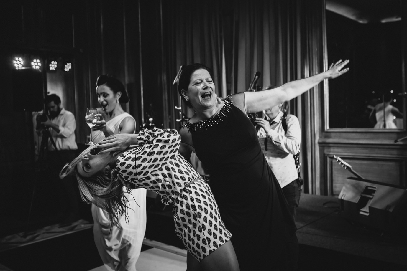 The dip. Dancing at Claridges, documentary wedding photography